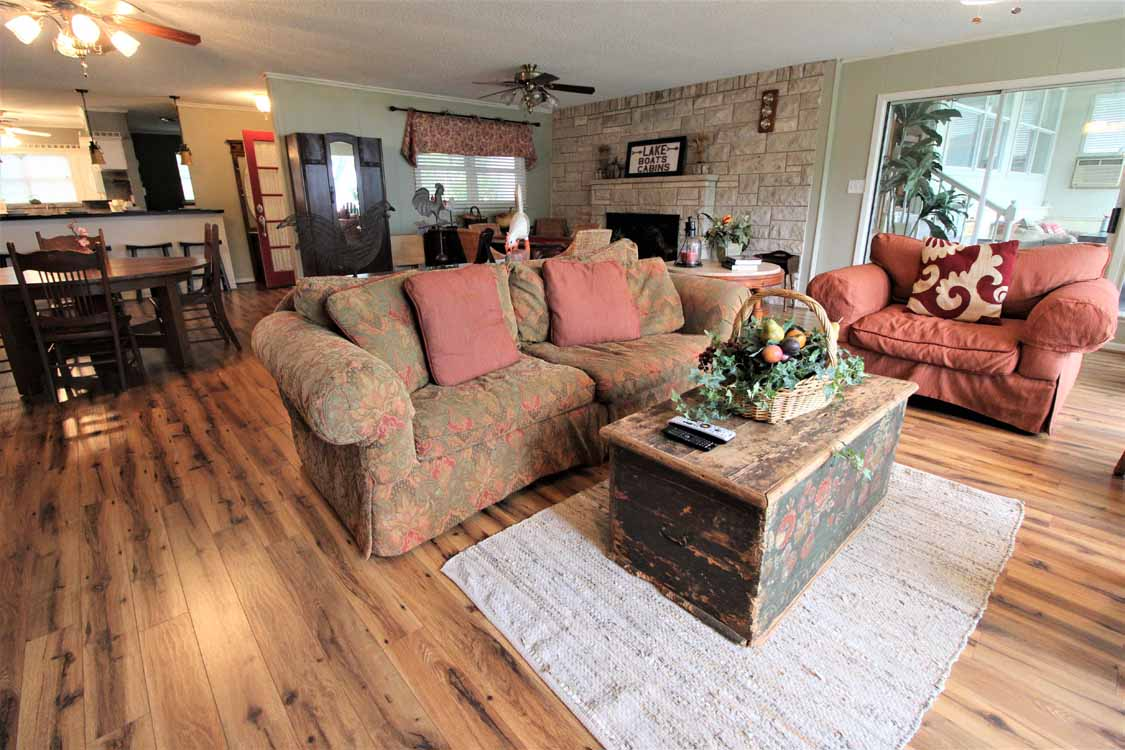 Lake Whitney, Texas vacation home rental | Lake Whitney Log Cabin rustic fireplace living room