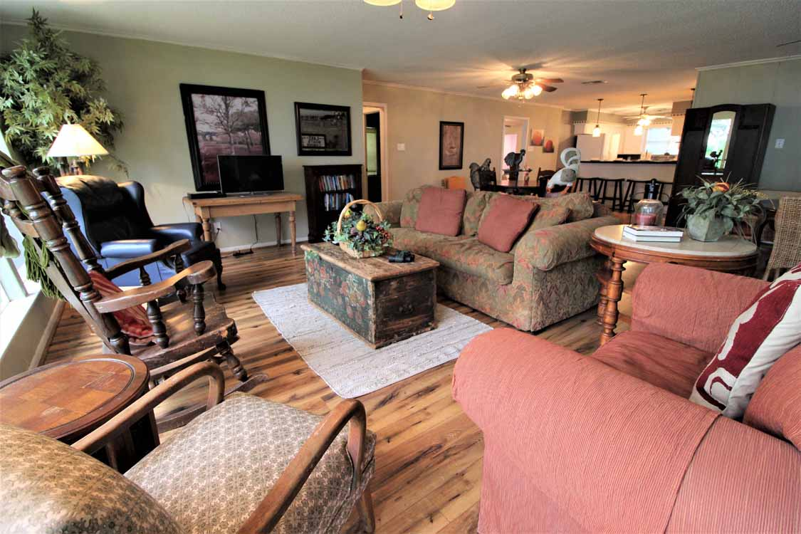 Lake Whitney, Texas vacation home rental | Lake Whitney Log Cabin with a rustic log cabin fireplace in the living room