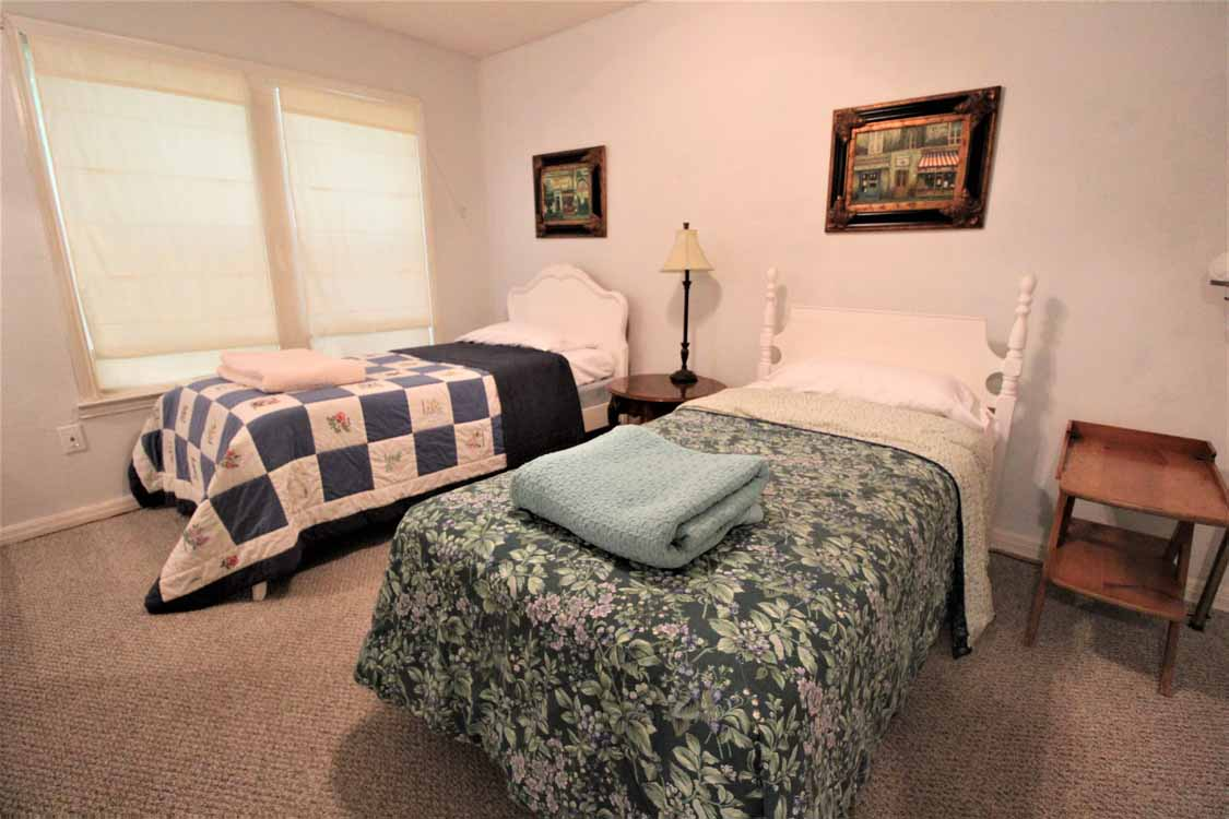Lake Whitney, Texas vacation home rental | Lake Whitney Log Cabin nearby fishing and swimming cove with boat ramp