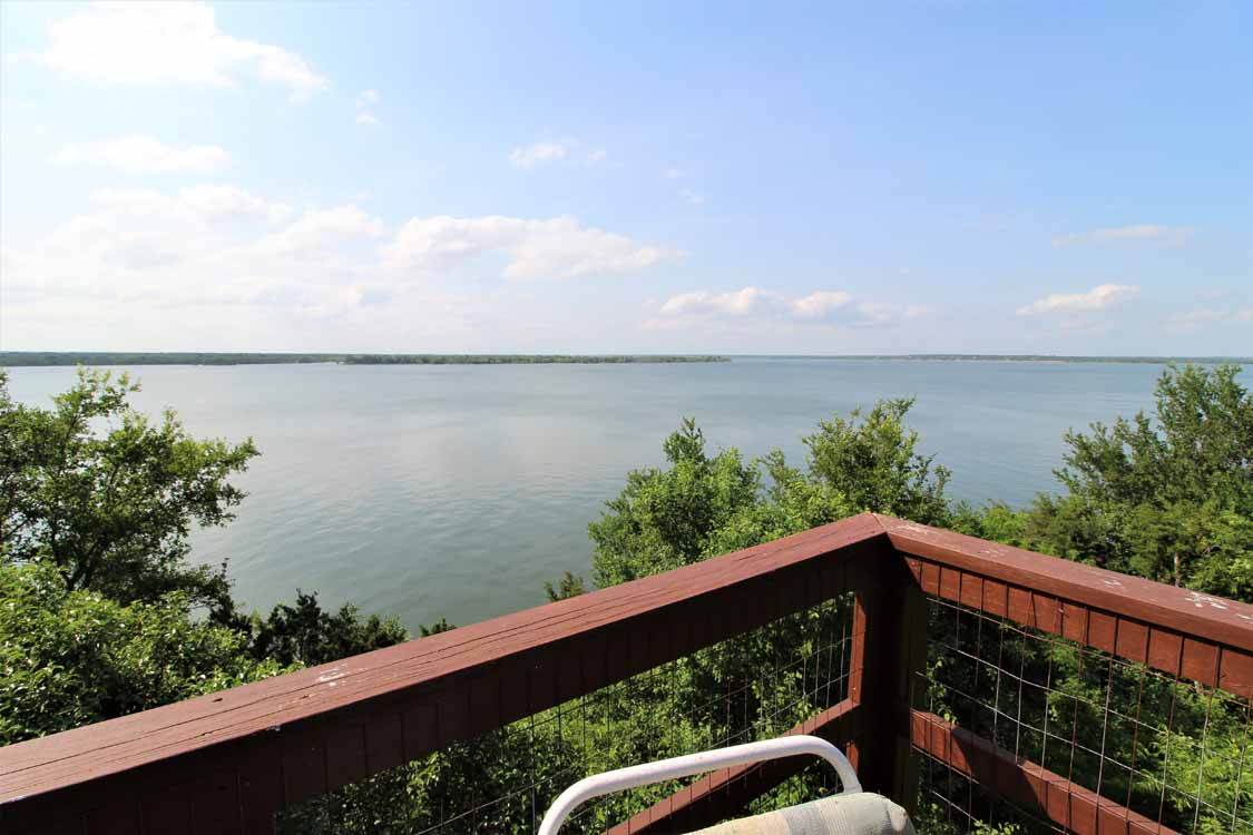 Lake Whitney, Texas vacation home rental | Lake Whitney Log Cabin covered porch